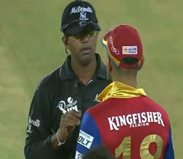 kohli_involved_in_verbal_spat_with_umpire_dharmasena_niharonline